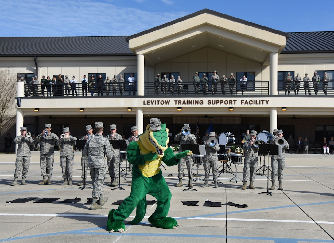 "The 334th Training Squadron ""Gator"" mascot dances a Drum and Bugle Corps performance during the 81st Training Group drill down on the Levitow Training Support Facility drill pad March 9, 2018, on Keesler Air Force Base, Mississippi. Airmen from the 81st TRG competed in a quarterly open ranks inspection, regulation drill routine and freestyle drill routine. The 335th TRS ""Bulls"" took first place this quarter. (U.S. Air Force photo by Kemberly Groue)"