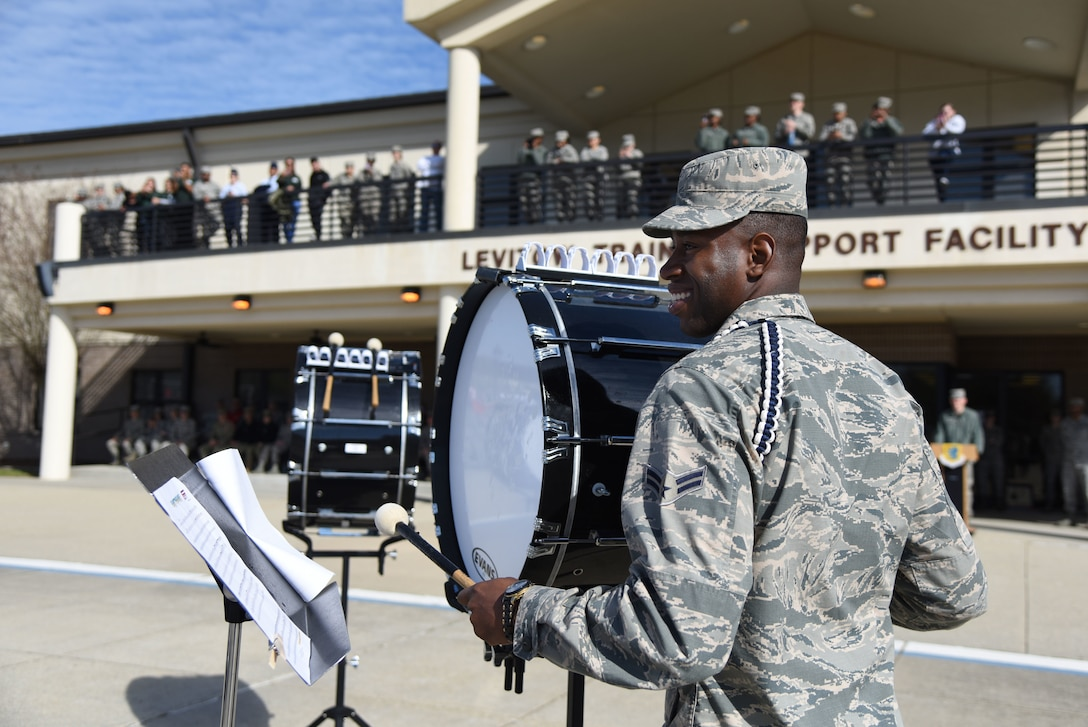 """U.S. Air Force Airman 1st Class Jeffrey Davis, 81st Training Group Drum and Bugle Corps member, performs during the 81st TRG drill down on the Levitow Training Support Facility drill pad March 9, 2018, on Keesler Air Force Base, Mississippi. Airmen from the 81st TRG competed in a quarterly open ranks inspection, regulation drill routine and freestyle drill routine. The 335th Training Squadron """"Bulls"""" took first place this quarter. (U.S. Air Force photo by Kemberly Groue)"""