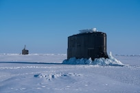 Ice Camp Skate (March 10, 2018) – Seawolf-class submarine USS Connecticut SSN 22 and Los Angeles-class fast-attack submarine USS Hartford SSN 768 breakthrough the ice March 9, 2018 in support of Ice Exercise (ICEX) 2018. ICEX 2018 is a five-week exercise that allows the Navy to assess its operational readiness in the Arctic, increase experience in the region, advance understanding of the Arctic environment, and continue to develop relationships with other services, allies and partner organizations. (U.S. Navy photo by Mass Communication 2nd Class Micheal H. Lee)