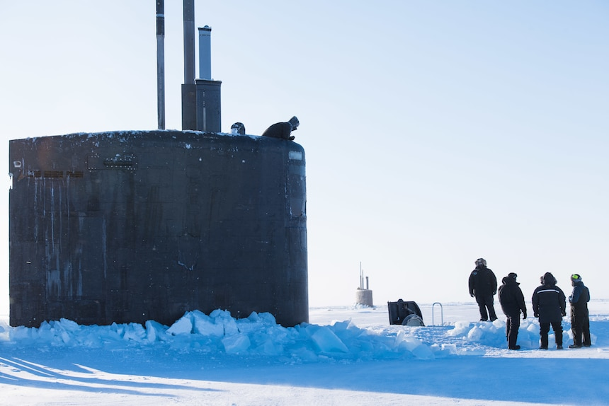 Ice Camp Skate (March 9, 2018) – Los Angeles-class fast-attack submarine USS Hartford SSN 768 surfaces through the ice March 9, 2018 in support of Ice Exercise (ICEX) 2018. ICEX 2018 is a five-week exercise that allows the Navy to assess its operational readiness in the Arctic, increase experience in the region, advance understanding of the Arctic environment, and continue to develop relationships with other services, allies and partner organizations. (U.S. Navy photo by Mass Communication 2nd Class Micheal H. Lee)