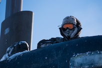 180316-N-KC128-269 Ice Camp Skate (March 16, 2018) – Chief Hospital Corpsman Kristopher Mandaro, assigned to Underwater Construction Team One (UCT 1), surfaces from a waterhole during a torpedo exercise in the Arctic Circle in support of Ice Exercise (ICEX) 2018, March 16. ICEX 2018 is a five-week exercise that allows the Navy to assess its operational readiness in the Arctic, increase experience in the region, advance understanding of the Arctic environment, and continue to develop relationships with other services, allies and partner organizations. (U.S. Navy photo by Mass Communication Specialist 1st Class Daniel Hinton)