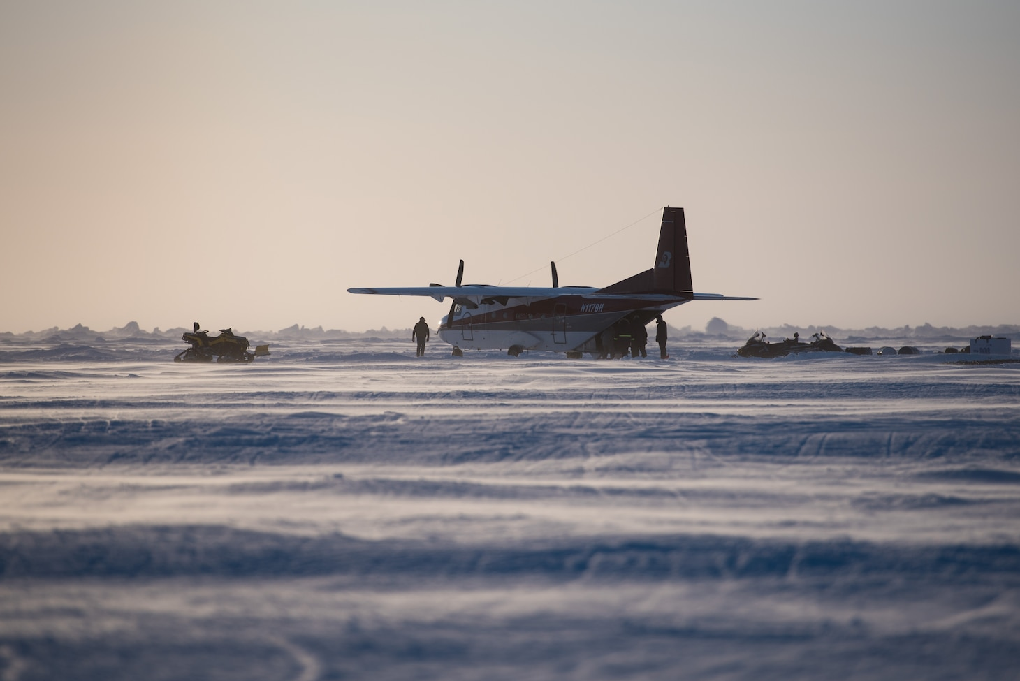 Members of Ice Camp Skate load cargo into a plane March 9, 2018 in support of Ice Exercise (ICEX) 2018. ICEX 2018 is a five-week exercise that allows the Navy to assess its operational readiness in the Arctic, increase experience in the region, advance understanding of the Arctic environment, and continue to develop relationships with other services, allies and partner organizations. (U.S. Navy photo by Mass Communication 2nd Class Micheal H. Lee)