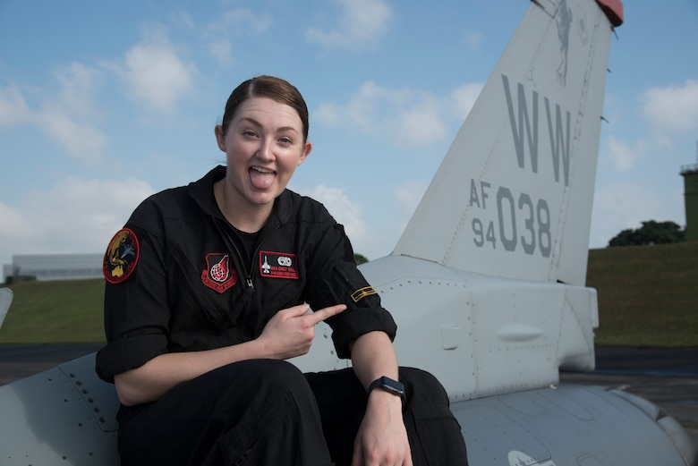 U.S. Air Force Senior Airman Emily Wall, a Pacific Air Forces' Demonstration Team crew chief, pauses for a photo after performing maintenance on an F-16 Fighting Falcon at Paya Lebar Air Base, Singapore, Feb. 3, 2018. As a surprise to her family, Wall took a different route than her siblings and enlisted in the military knowing she wanted to impact her peers, travel the world and make a difference for her country. After her four years of experience, she now encourages other women in her profession to push through and overcome adversity in the maintenance world. (U.S. Air Force photo by Senior Airman Sadie Colbert)