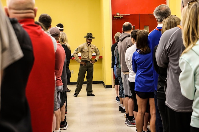 A drill instructor speaks to educators at Marine Corps Recruit Depot San Diego, Calif., during the Recruiting Station St. Louis Educators Workshop, March 5-9. The purpose of the workshop is to identify and provide selected educators and other community influencers the opportunity to gain first-hand experience on how the Marine Corps transforms young men and women into U.S. Marines. This workshop provides current information regarding  Marine Corps recruit training practices and procedures, military job skills and opportunities, military lifestyle, and educational benefits available to Marines. The intent of the program is to demystify the recruit training experience and foster closer relationships between recruiting station personnel and those in their communities who have influence on the decisions of young men and women.