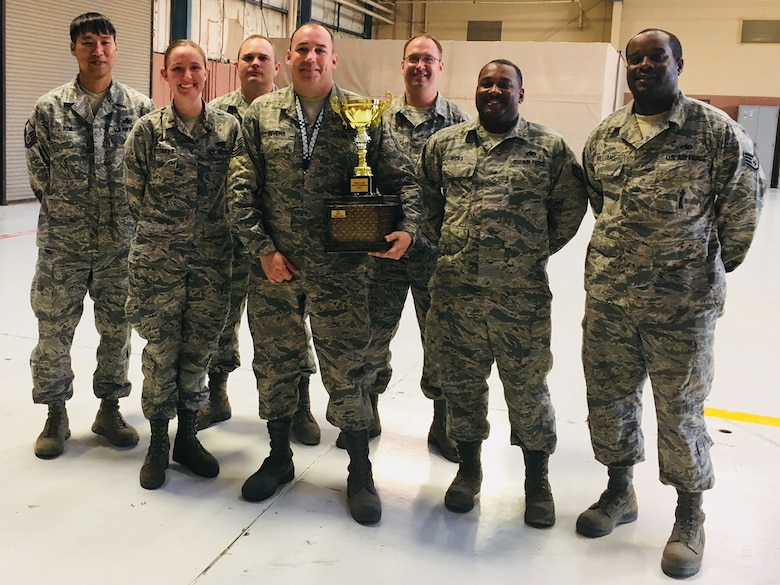 "U.S. Airmen assigned to the 20th Aircraft Maintenance Squadron, 55th Aircraft Maintenance Unit, hold the Outstanding Maintenance Unit award, also known as the ""Commander's Cup,"" at the conclusion of Exercise Red Flag 18-1 at Nellis Air Force Base, Nevada."