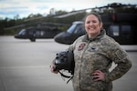U.S. Army National Guard Chief Warrant Officer 3 Kristina Sofchak in front of a UH-60L Black Hawk helicopter at the New Jersey National Guard's Army Aviation Support Facility, Joint Base McGuire-Dix-Lakehurst, N.J., March 5, 2018. Sofchak is a Black Hawk helicopter maintenance test pilot with Det. 2 , C Company, 1-171st Aviation.