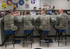 Airmen from the 130 AW enjoy lunch at the newly dedicated Props & Wings dining facility on March 4, 2018.  Historical photos line the walls and portray the wings unique history. The newly designed dining facility features a historical timeline of our rich Air Force heritage.  (U.S. Air National Guard photo by Tech. Sgt. De-Juan Haley)