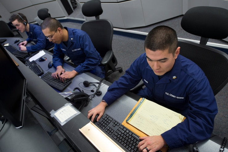 A Coast Guard Information Systems Technician adjusts cables inside a server room at the Telecommunication and Information Systems Command (TISCOM) Jan. 24, 2013.