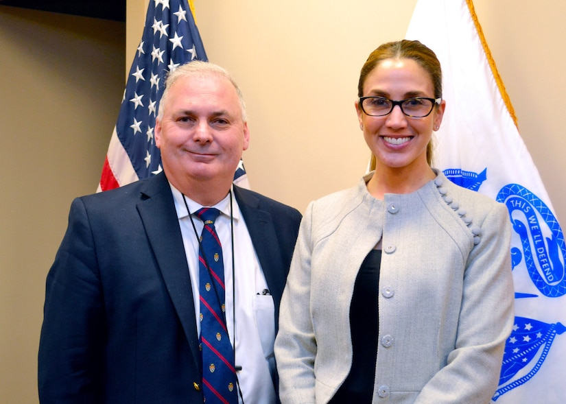 William Kenny, DLA Troop Support executive director of contracting and acquisition management, stands with Lauren Colabelli, a team chief with the Construction and Equipment supply chain. Colabelli was a member of a task force to bring generators to provide temporary electric power to Texas, Florida, Puerto Rico and the Virgin Islands in the wake of the string devastating hurricanes that swept through earlier in 2017.