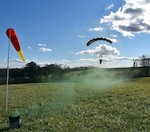 Staff Sgt. Steven Lunn approaches the drop zone during his military free fall qualification jump over Paddy's Field in Mechanicsburg, Pennsylvania.