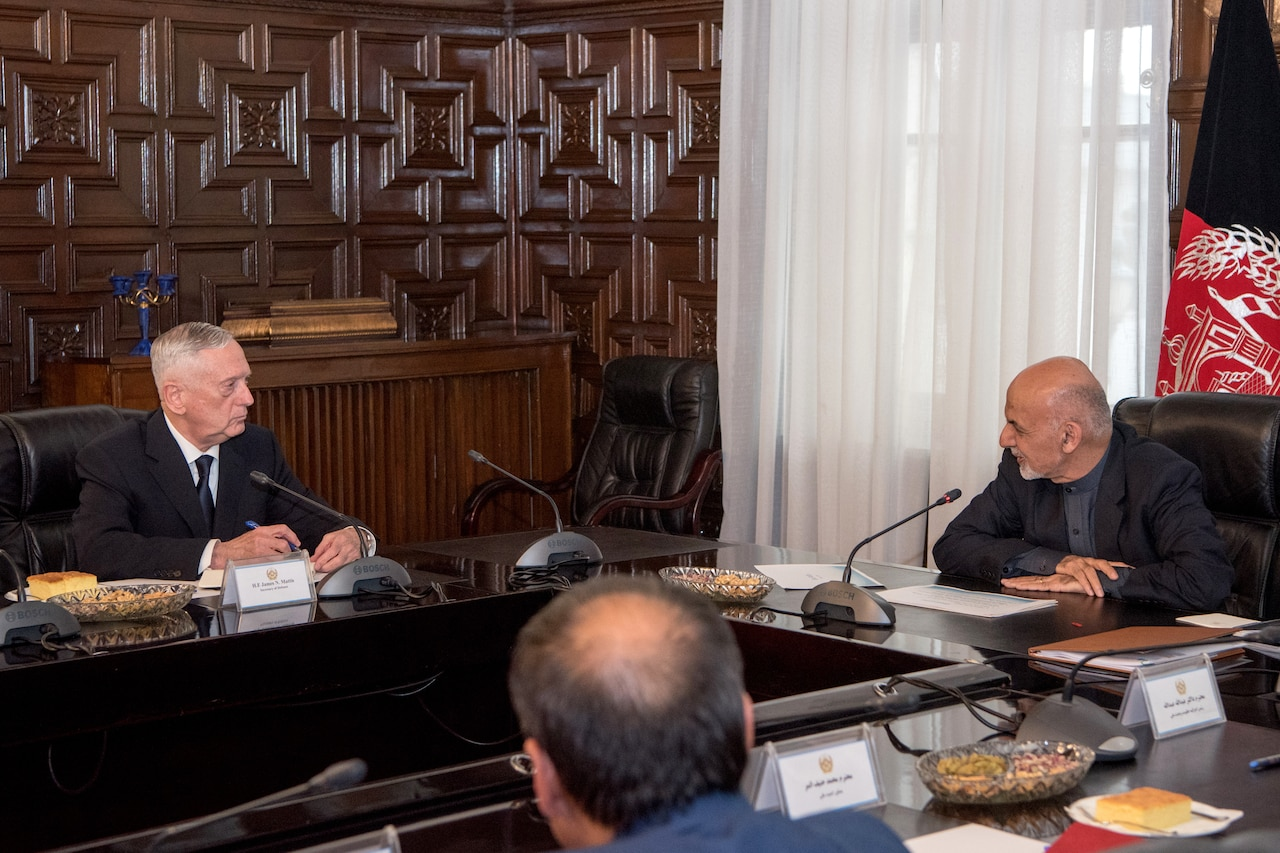 Defense Secretary James N. Mattis sits at a table with the Afghan president.