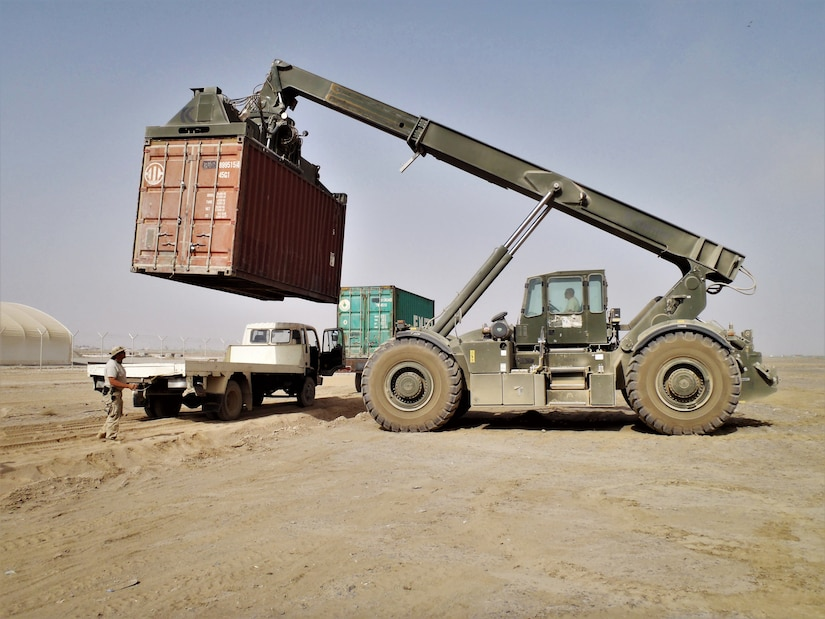 A container of supplies is lifted onto a local truck for delivery to customers in Kandahar, Afghanistan. DLA Distribution and DLA Disposition Services employees continue to volunteer for deployments to Afghanistan so they can have a direct and quick impact on military missions there.