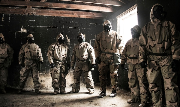Members of DLA's rapid deployment Red Team brave the gas chamber to conduct a functions test on personal protective equipment during nuclear, biological and chemical training at Camp Atterbury, Indiana.