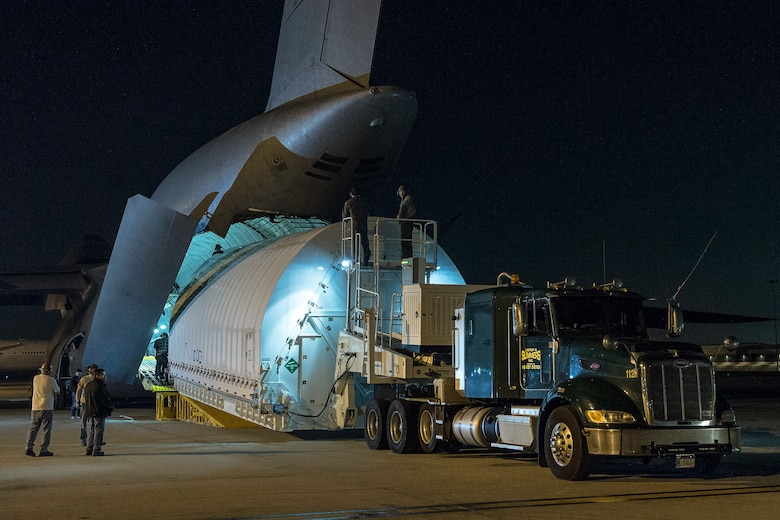 The Space Telescope Transporter for Air, Road and Sea (STTARS), a specially designed shipping container that held the optical telescope and integrated science instrument module (OTIS) of NASA's James Webb Space Telescope, is unloaded from a specially-modified C-5 Charlie aircraft at Los Angeles International Airport Feb. 2, 2018. The STTARS was certified for flight aboard the aircraft by the Air Force Life Cycle Management Center's Air Transportability Test Loading Activity May 15, 2014. (NASA photo/Chris Gunn)