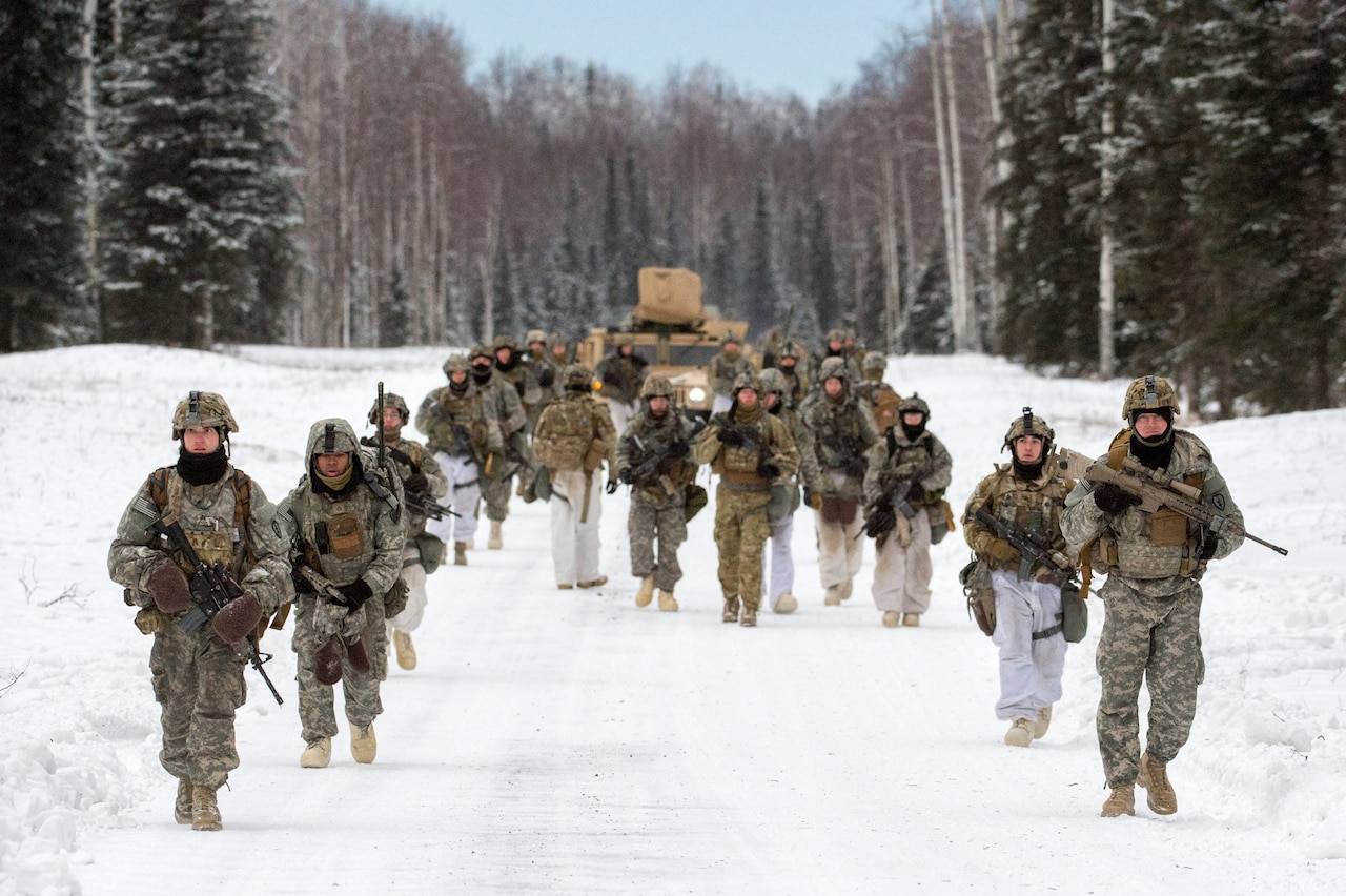 Soldiers from the 25th Infantry Division march during Operation Punchbowl at Joint Base Elmendorf-Richardson, Alaska.