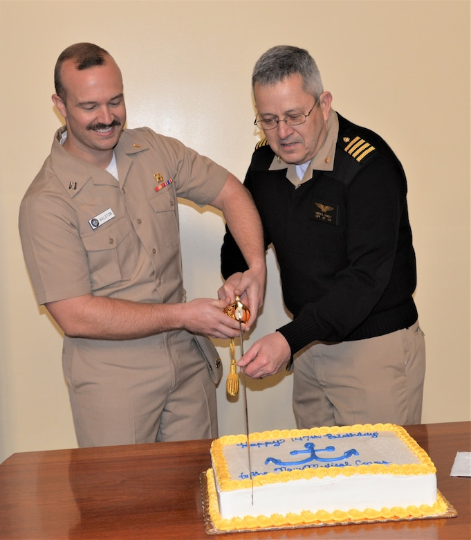 U.S. Navy Lt. Raymond Walston, a physician serving at Naval Health Clinic Charleston, and U.S. Navy Capt. Keith Hanley, NHCC's chief medical officer, cut the cake during a ceremony celebrating the 147th birthday of the Navy Medical Corps.