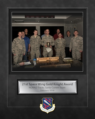 The NORAD Tracks Santa Communications Team won the Gold Knight Award on Peterson Air Force Base, Colorado, Feb. 28, 2018. The Gold Knight award was presented to the team for their efforts with the 2017 NORAD Tracks Santa project, allowing the volunteers to answer 126,000 phone calls from children on six different continents. (U.S. Air Force photo by Airman 1st Class Alexis Christian