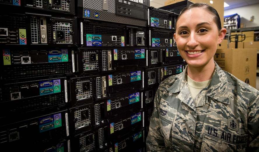 Staff Sgt. Kayce Crisp, an informatinon systems technician from the 59th Medical Wing, explains the process of upgrading a computer's operating system March 13, 2018 at Joint Base San Antonio-Lackland, Texas. The 59MDW information technician staff upgraded a record amount of more than 3,700 systems to maintain Air Force standards. (U.S. Air Force photo by Senior Airman Keifer Bowes)