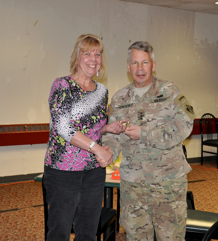 LOUISVILLE, Ky. – USACE Commanding General Lt. Gen. Todd Semonite recognizes Bev Noel-Chavez for her service as the Critical Incident Stress Management team coordinator, during the team's annual training, Feb. 28, 2018.