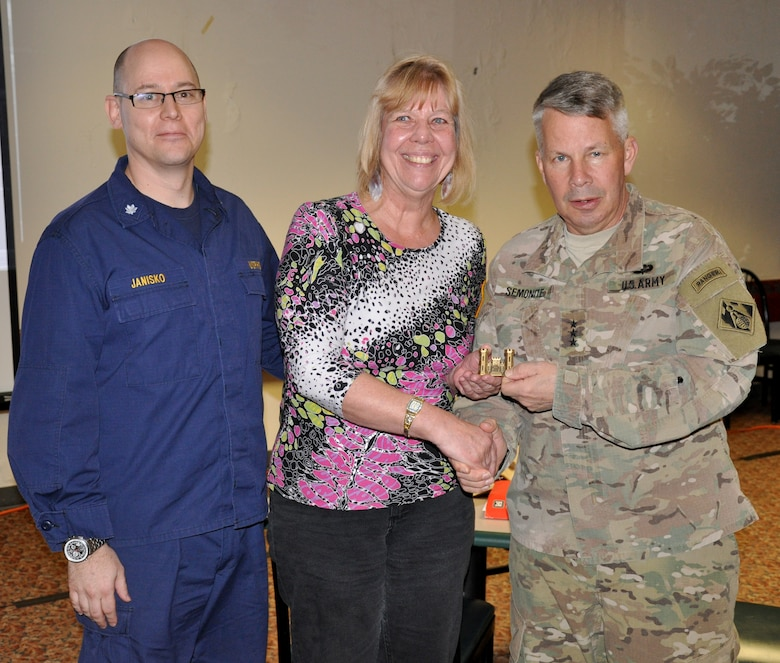 LOUISVILLE, Ky. – USACE Commanding General and 54th US Army Chief of Engineers Lt. Gen. Todd Semonite (right) and USACE Command Surgeon Thomas Janisko recognize Bev Noel-Chavez for her service as the Critical Incident Stress Management team coordinator, during the team's annual training, Feb. 28, 2018.