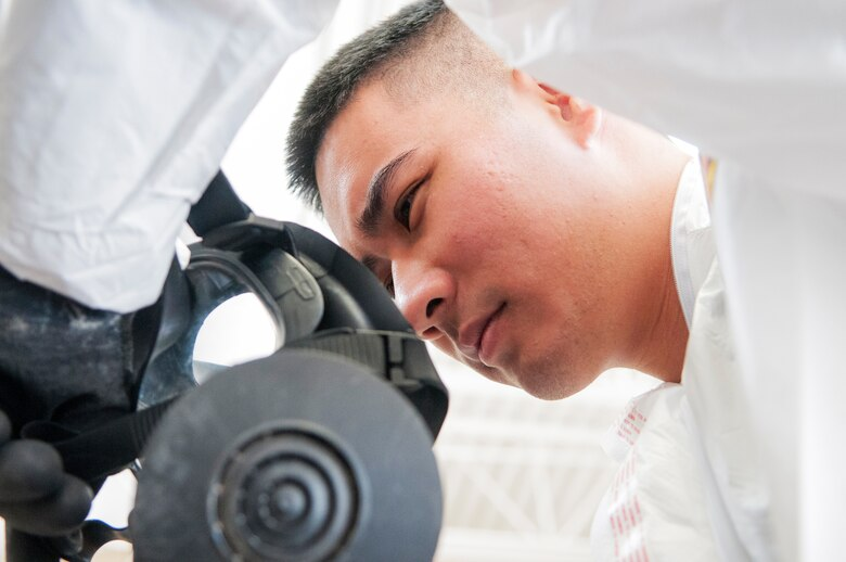 Senior Airman Nicklaus Young an aerospace medical technician with the  Detachment 1, 154th Medical Group, dons his gas mask at a Medical Capabilities exercise held in North Las Vegas, Jan. 27, 2018.