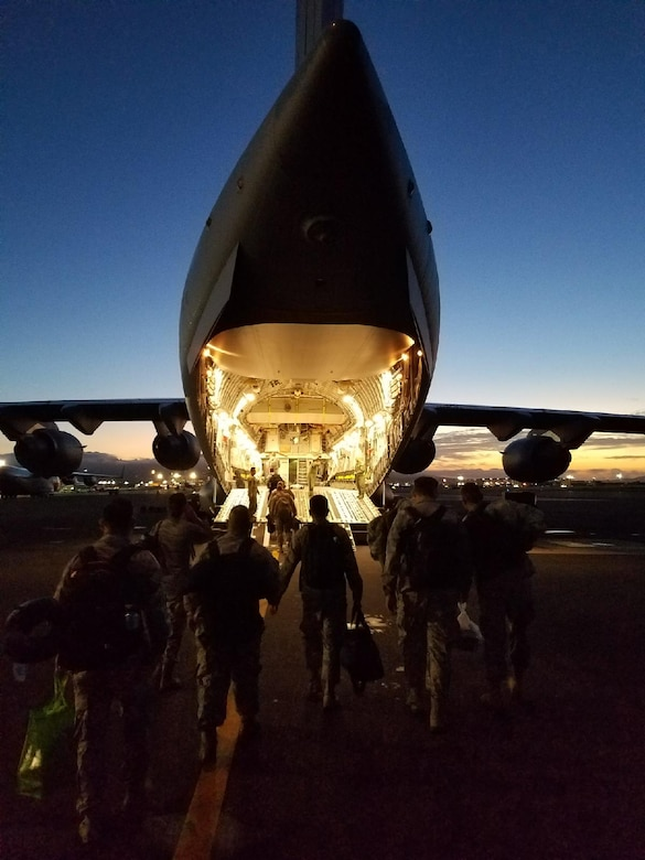 Airmen from the 154th Medical Group, Detachment 1, board a C-17 Globemaster III assigned to the 204th Airlift Squadron,  Joint Base Pearl Harbor-Hickam, Jan. 26, 2018.