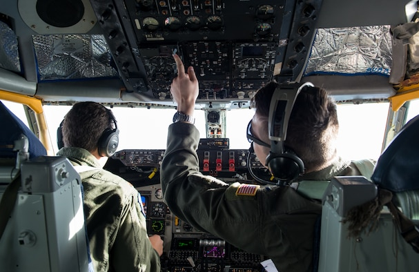 A KC-135 Stratotanker pilot assigned to the 452nd Air Mobility Wing presses a switch during an in-flight refueling mission over Arizona, March 12, 2018. Luke Air Force Base provided an opportunity for military spouses to experience an in-flight refueling mission in a KC-135 Stratotanker. (U.S. Air Force photo/Airman 1st Class Alexander Cook)