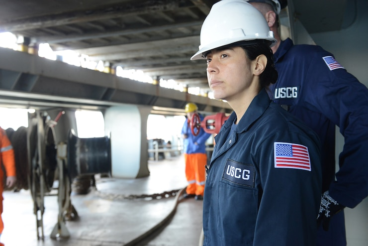 Petty Officer 3rd Class Danielle Montez conducts a safety examination of firefighting gear aboard the Liberian-flagged container ship MSC Vaishnavi R. Monday, February 6, 2017 in Boston