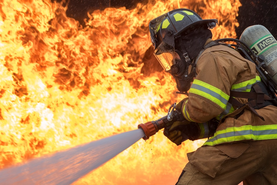 U.S. Air Force Senior Airman Eric Poole, 374th Civil Engineer Squadron firefighter, battles a simulated aircraft fire during live-fire training at Yokota Air Base, Japan, March 8, 2018. Aircraft live-fire training is conducted periodically throughout the year to ensure Airmen and civilians with the 374th CES and 374th Maintenance Squadron repair and reclamation section are always prepared to combat aircraft fuel fires. (U.S. Air Force photo by Yasuo Osakabe)