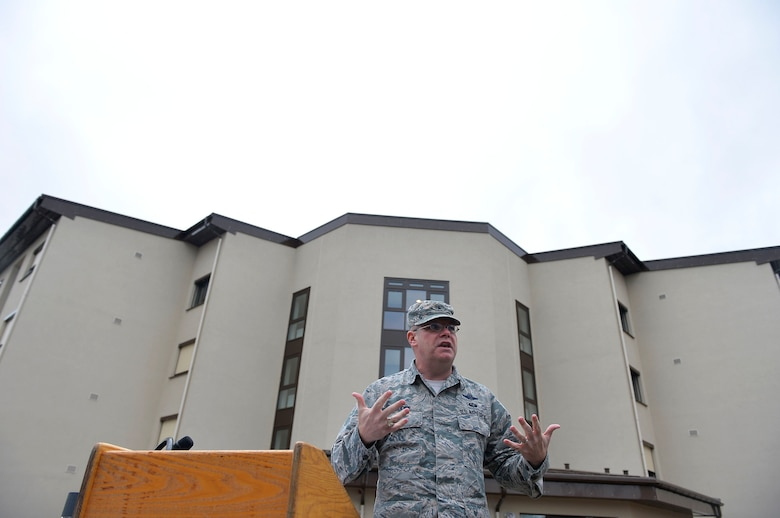 U.S. Air Force, Brig. Gen. Richard G. Moore Jr. gives remarks during a ribbon-cutting ceremony on Ramstein Air Base, Germany, March 7, 2018. The building project for dorm 2411 took more than ten years to complete if counting the planning stage. (U.S. Air Force photo by Senior Airman Joshua Magbanua)