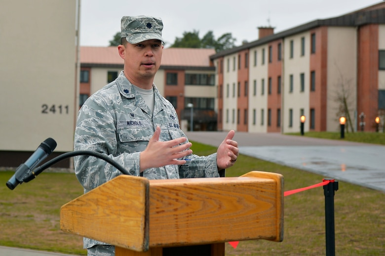U.S. Air Force Lt. Col. George Nichols, 86th Civil Engineer Squadron commander, gives remarks during a ribbon-cutting ceremony on Ramstein Air Base, Germany, March 7, 2018. The building project for dormitory 2411 saw involvement from the 86th CES, Air Force Civil Engineer Center, U.S. Army Corps of Engineers, and Kaiserslautern State Construction Agency. (U.S. Air Force photo by Senior Airman Joshua Magbanua)