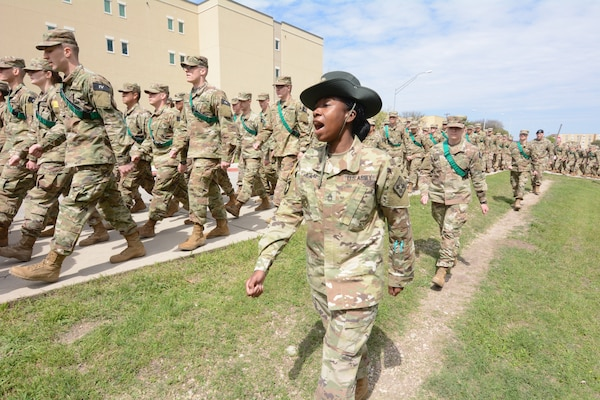 Sgt. 1st Class Magalie Atilus, Delta Company, 232d Medical Battalion, marches with Advanced Individual Training Soldiers at Joint Base San Antonio-Fort Sam Houston, Texas. Atilus recently graduated from the Drill Sergeant Conversion Course at Fort Jackson, SC.