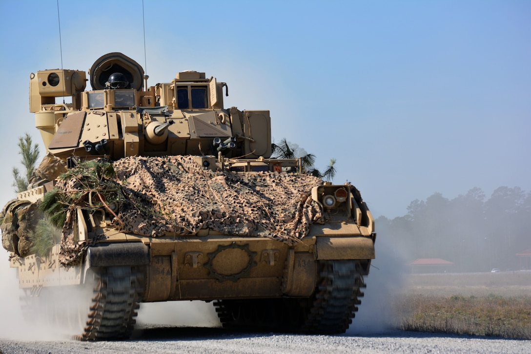 An M2A2 Bradley Fighting Vehicle from 1st Battalion, 64th Armor Regiment maneuvers during a company Combined Arms Live-Fire Exercise at Fort Stewart, Georgia Feb. 7, 2017.