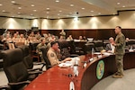 Col. John Maykish, 609th Air Operations Center commander, holds a brainstorming session on the future of the Combined Air Operations Center, during the second annual innovation summit, Al Udeid Air Base, Qatar, March 8, 2018. The innovation summit brought military and academic minds together to brainstorm warfighting challenges and assess progress made in collaboration between the Defense Innovation  experimental Unit and the Combined Air Operations Center. (U.S. Air Force photo by Staff Sgt. Jeff Parkinson)