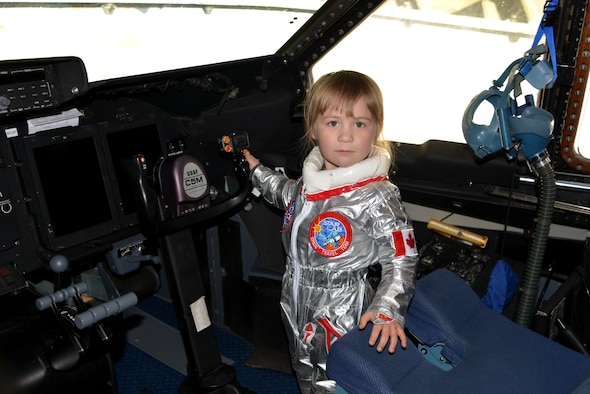 "Ready for flight, 3-year-old, Victoria from British Columbia, stands inside of the 433rd Airlift Wing's  C-5M Super Galaxy aircraft, during the Abbotsford International Airport in Abbotsford British Columbia, Canada to celebrate a week of International Women's Day, March 10-11, 2018 during the ""Sky's the limit-Girls fly too,"" Airshow. (U.S. Air Force photo by Ms. Minnie Jones)"