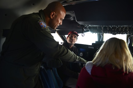 "Lt. Col. Chris Jones, 68th Airlift Squadron, pilot gives a tour of the C-5M Super Galaxy, at the Abbotsford International Airport in Abbotsford British Columbia, Canada. The airport celebrated a week of International Women's Day, March 10-11, 2018, during the ""Sky's the limit-Girls fly too"" Airshow.  Jones, discussed the aircraft's latest upgrades, which provides the aircraft with more capability, reliability, and affordability. (U.S. Air Force photo by Ms. Minnie Jones)"