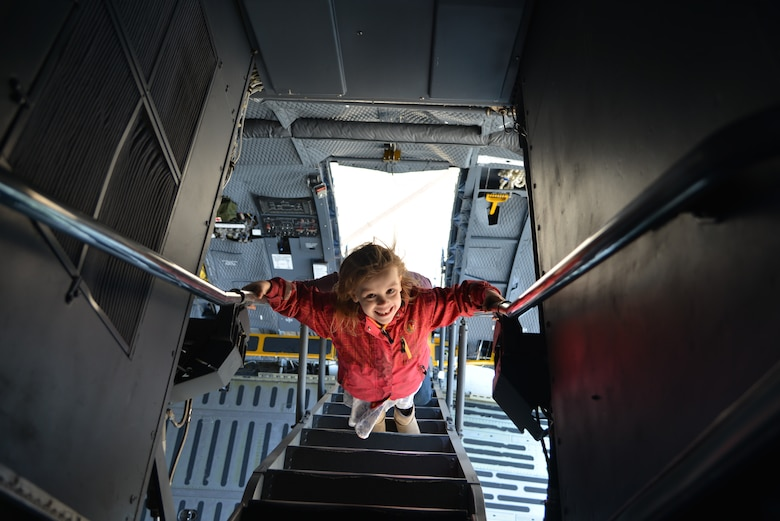 "Six-year-old Vivian, boldly climbs the C-5M Super Galaxy's ladder up to the cockpit, during the Sky's the limit-Girls fly too"" Airshow at the Abbotsford International Airport's in British Columbia, Canada. The airport celebrated a week of International Women's Day, March 10-11, 2018. (U.S. Air Force photo by Ms. Minnie Jones)"