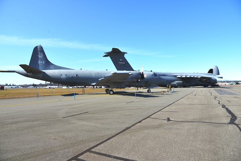 "Preparing for the airshow, Canada's CP-140 Lockheed Aurora in the forefront of the 433rd Airlift Wing's C-5M Super Galaxy at the Abbotsford International Airport, in Abbotsford British Columbia, Canada to celebrate a week of International Women's Day, March 10-11, 2018 at the ""Sky's the limit- Girls fly too"" airshow.  (U.S. Air Force photo by Ms. Minnie Jones)"