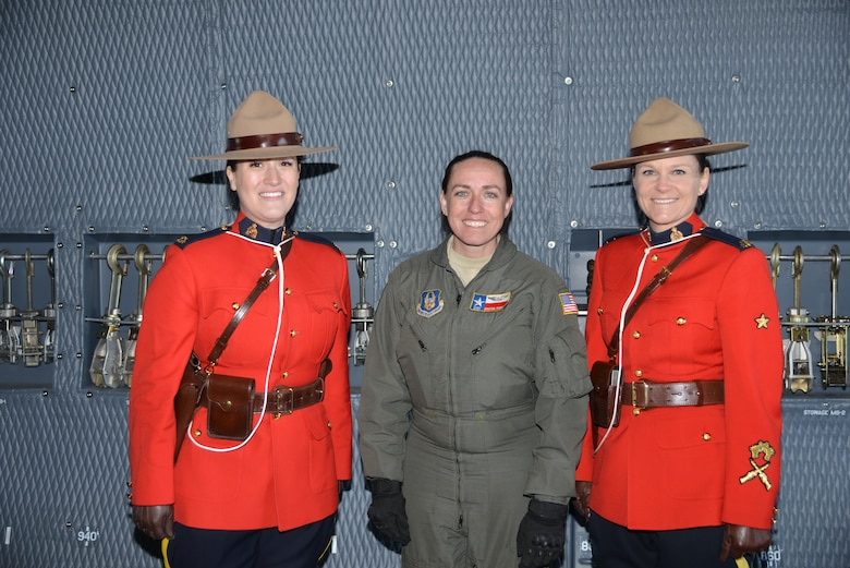 "Royal Canadian Mounted Police, Courtney Twolan and Lorelei Jeffrey pose with Staff Sgt. Kristine Thomas, loadmaster and affiliation Instructor, 433rd Contingency Response Flight loadmaster, and affiliation Instructor with the Joint Base San Antonio-Lackland, Texas during a tour of the C-5M Super Galaxy aircraft at the Abbotsford International Airport in Abbotsford British Columbia, Canada. The airport celebrates a week of International Women's Day, March 10-11, 2018, during the ""Sky's the limit-Girls fly too"" Airshow. The RCMP provides law enforcement at the federal level. It also provides policing on a contract basis to the three territories (Northwest Territories, Nunavut, and Yukon), and eight of Canada's provinces. (U.S. Air Force photo by Ms. Minnie Jones)"