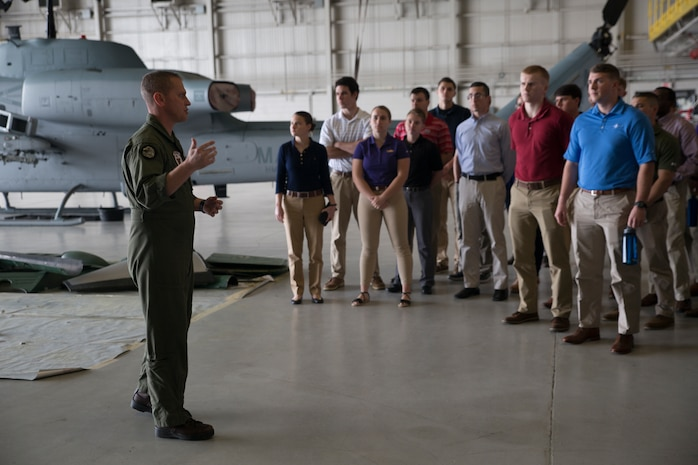Maj. Christopher J. Cayere, assistant operations officer, Marine Light Attack Helicopter Squadron 773, Marine Aircraft Group 49, 4th Marine Aircraft Wing, goes over different aircraft the squadron operates with Officer Candidate School applicants and candidates from the local Louisiana area, New Orleans, March 10, 2018. The candidates had the opportunity to view the aircraft at the squadron, talk with the pilots and learn about career opportunities in the Marine Corps. (U.S. Marine Corps photo by Sgt. Melissa Martens)