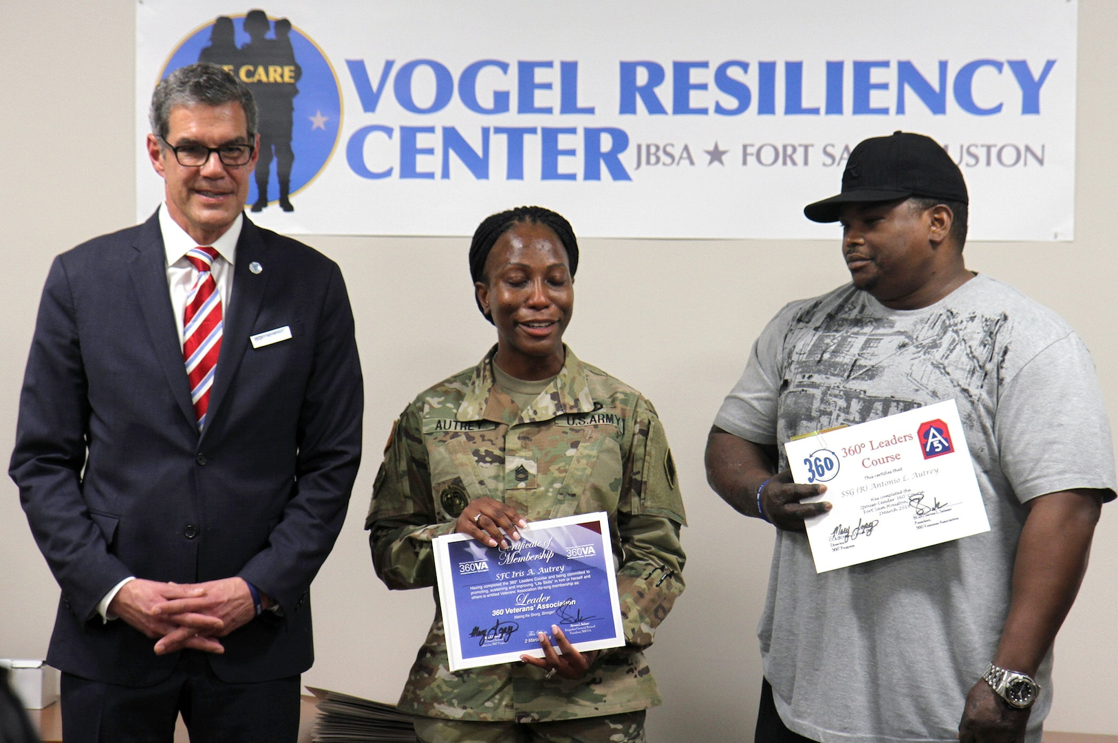 Sgt. 1st Class Iris Autrey (middle), a combat medic specialist with Company A, 187th Medical Battalion, gathers her thoughts before addressing her fellow graduating class members after receiving her certificate March 2 from the Soldier 360 Leadership Resiliency Course at the Vogel Resiliency Center at Joint Base San Antonio-Fort Sam Houston. Her husband, Antonio Autrey (right), also received a certificate as a participant in the course.