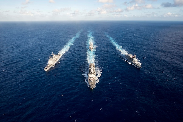 The guided missile destroyer USS Mustin leads the guided missile cruiser USS Antietam, the guided missile destroyer USS Curtis Wilbur and the Japan Maritime Self-Defense Force destroyer JS Fuyuzuki in a formation at the completion of the MultiSail 2018 exercise in the Philippine Sea, March 14, 2018. MultiSail is a bilateral training exercise improving interoperability between the U.S. and Japanese forces. Navy photo by Petty Officer 3rd Class Sarah Myers