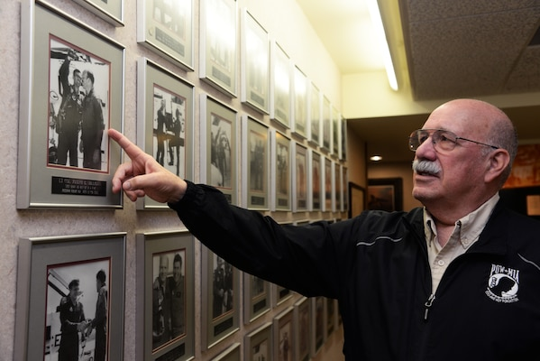 Retired Col. Joe Milligan looks at a photo of his Freedom Flight, March 13, 2018 at Joint Base San Antonio-Randolph, TX. Each year, Vietnam POWs are given the opportunity to have their freedom flight. Col. Milligan's is freedom flight No. 162 out of 198 to date. Three flights, 199-201, will take place as part of this year's reunion. (U.S. Air Force photo by Senior Airman Gwendalyn Smith)