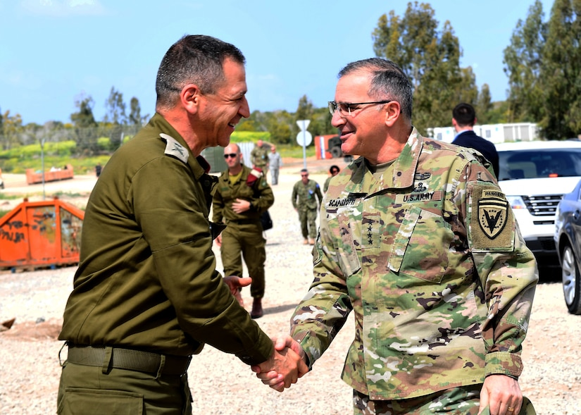 Army Gen. Curtis M. Scaparrotti, commander of U.S. European Command and NATO's supreme allied commander for Europe, shakes hands with deputy chief of the Israeli General Staff Maj. Gen. Aviv Kochavi at Hatzor Air Force Base, Israel.