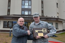 U.S. Air Force Brig. Gen. Richard G. Moore Jr., 86th Airlift Wing commander, right, receives a plaque keys from Dave Nichols of the U.S. Army Corps of Engineers during a ribbon-cutting ceremony on Ramstein Air Base, Germany, March 7, 2017. The building project for dormitory 2411 saw involvement from the 86th CES, Air Force Civil Engineer Center, U.S. Army Corps of Engineers, and Kaiserslautern State Construction Agency. (U.S. Air Force photo by Senior Airman Joshua Magbanua)