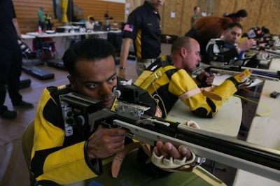 Recuperating Soldier fires air rifle in training