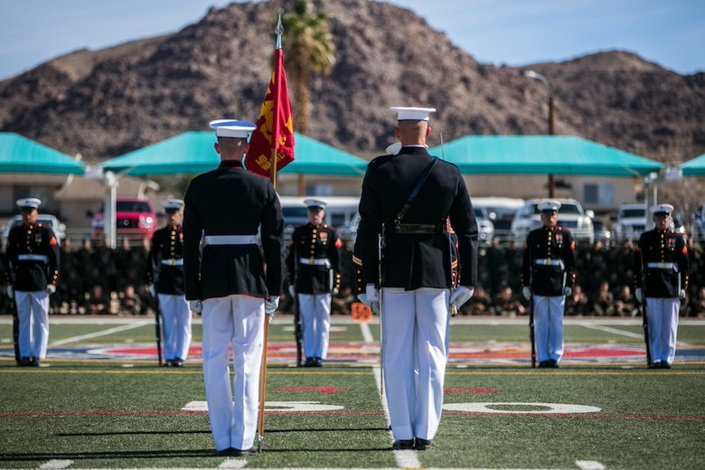 The U.S Marine Corps Silent Drill Platoon, Battle Colors Detachment, Marine Barracks Washington, D.C., performs during the Battle Colors Ceremony at Felix Field aboard the Marine Corps Air Ground Combat Center, Twentynine Palms, Calif., March 14, 2018. The ceremony is held to honor Marine Corps traditions through the Drum Corps, the Silent Drill Platoon and the Battle Colors Detachment.