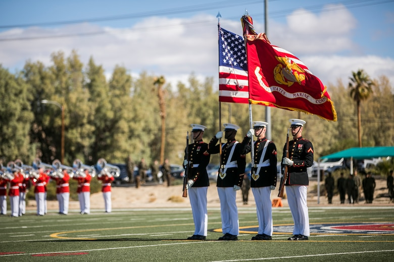 The U.S. Marine Corps Commandant's Four, Battle Colors Detachment, Marine Barracks Washington, D.C., present the colors during a Battle Colors Ceremony at Felix Field aboard the Marine Corps Air Ground Combat Center, Twentynine Palms, Calif., March 14, 2018.  The ceremony is held to honor Marine Corps traditions through the Drum Corps, the Silent Drill Platoon and the Battle Colors Detachment.