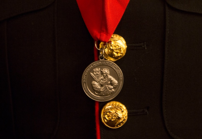 Master Gunnery Sgt. Lamar Burris displays his St. Barbara's Medallion during a St. Barbara's Day celebration, March 9, 2017. The Honorable Order of St. Barbara recognizes Marines for their accomplishments in the artillery occupation. Burris, a native of Gastonia, North Carolina, is with 3rd Battalion, 12th Marine Regiment, 3rd Marine Division.