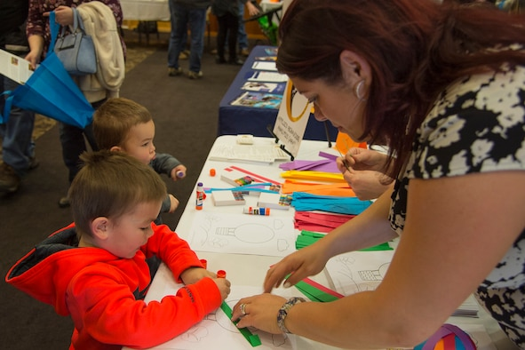 Jaxon and Kastor Clippinger make paper balloons with Maria Loveless, Applied Behavior Connections, at the Special Needs Summit March 15, 2018, at Hill Air Force Base, Utah. (U.S. Air Force photo by Airman 1st Class James Kennedy)
